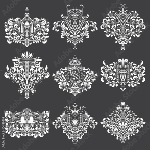 Set Of Ornamental Monogram In Coats Of Arms Form White Floral
