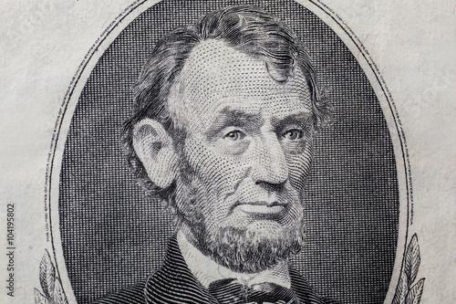 Fotografia  Portrait of US President Abraham Lincoln on the five dollar bill, background of the money, five dollar bills front side obverse