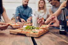 Friends Partying And Eating Pizza