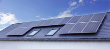 Solar Panels On House Roof. Su...