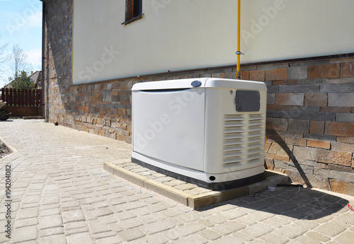 Big Backup Natural Gas Generator for House Building Outdoor Fototapet