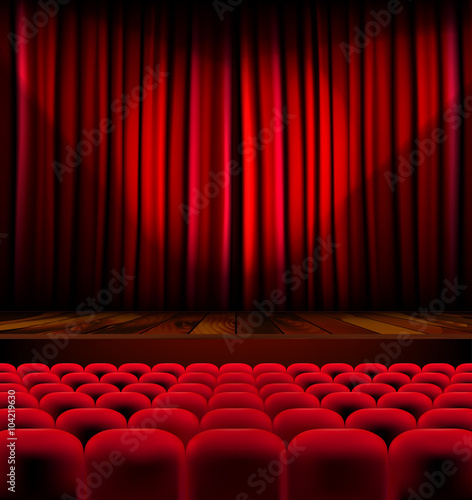 Fotografía  Theater auditorium with rows of seats and stage with curtain