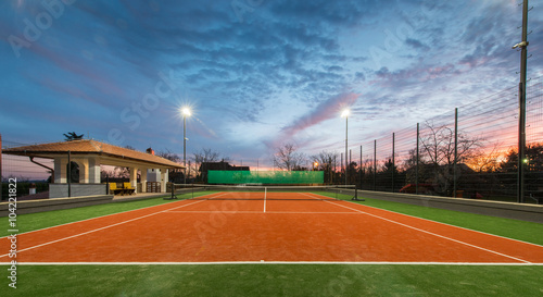 Tennis court and magic sky