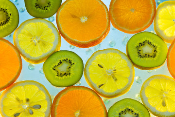 FototapetaBackground of fruit in water with bubbles