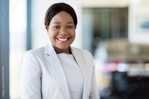 Fototapety, obrazy: african saleswoman standing at car dealership