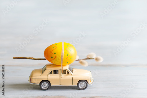Easter eggs and catkins on car abstract retro concept Wallpaper Mural