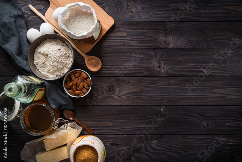 Photo Ingredients for baking on a wooden background top view