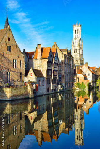 In de dag Brugge Brugge architecture among the canal reflected in water, Vertical view of Belgium