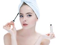 Woman Applying Black Mascara O...