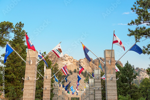 Fotografie, Obraz  Row of state flags leading to Mount Rushmore in Keystone, South Dakota