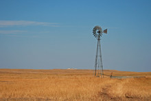 Windmill Pumping Water In Fairburn South Dakota Between The East Side Of The Black Hills And The South Dakota Badlands