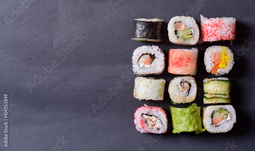 Poster Sushi bar Sushi rolls on a black