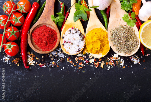 mixed spices with fresh vegetables - 104362868