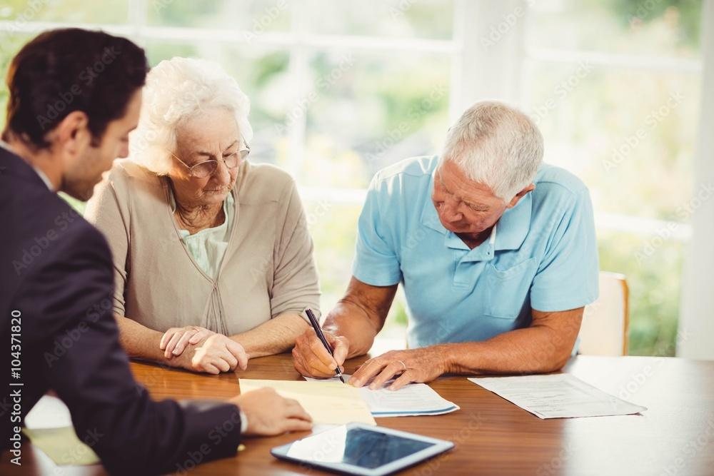 Fototapeta Senior man signing document