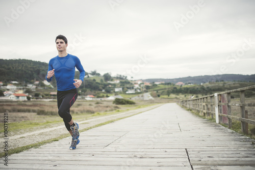 Spain, Ferrol, jogger running on a boardwalk