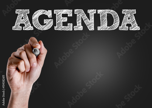 Photo Hand writing the text: Agenda