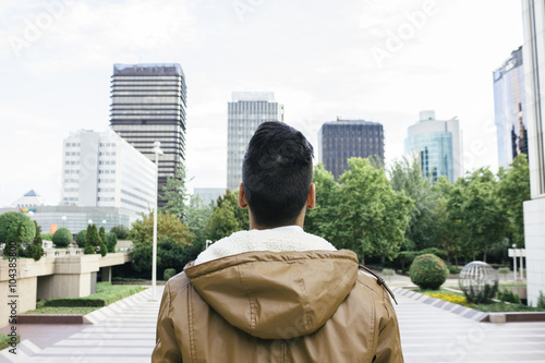 Spain, Madrid, young man with a leather jacket in the city