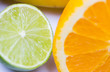 close up of fresh juicy orange and lime