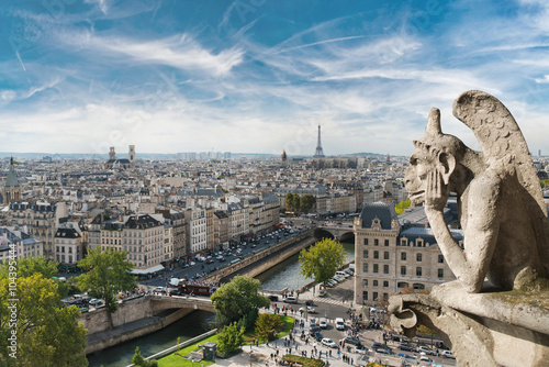 Poster Parijs Gargoyle and wide city view from the roof of Notre Dame de Paris