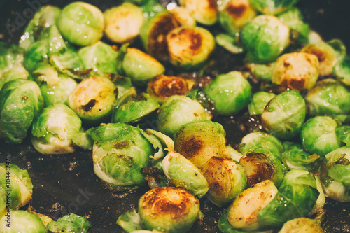 Photo Stands Brussels Roasted Brussels sprouts in a pan, close up
