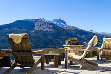 Wooden Easy Chairs At A Mountain Lodge Terrace, Klosters Switzer
