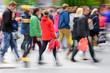 Motion blurred pedestrians crossing street