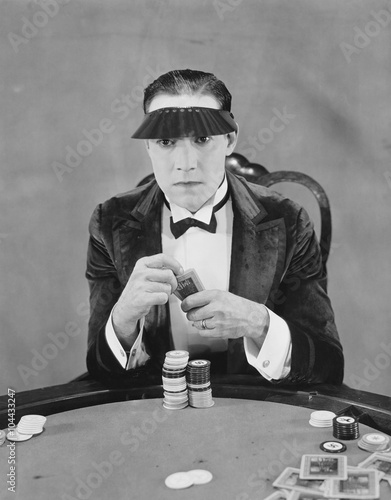 Portrait of gambler at card table плакат