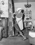 Woman doing housework with a vacuum cleaner  - 104434601