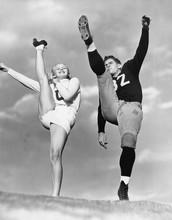 Cheerleader And Football Playe...