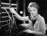 Young woman working as a telephone operator  - 104438817