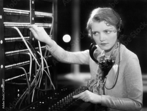Fotografía  Young woman working as a telephone operator