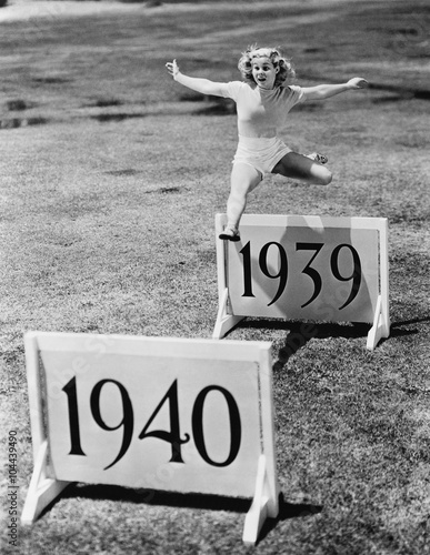 Fotografia  Woman jumping hurdles labeled with years