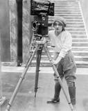 Woman operating movie camera  - 104440494