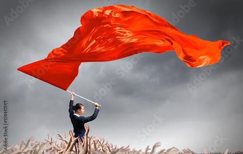 Woman waving red flag Fototapeta