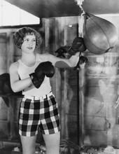 Female Boxer Using Punching Bag