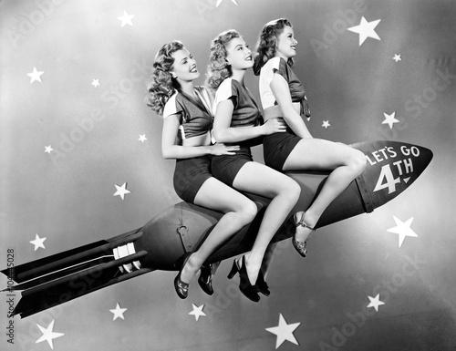 Valokuva  Three women sitting on a rocket