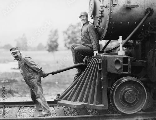Engineers pulling train engine Canvas Print