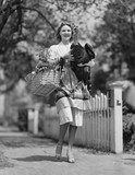 Woman carrying live turkey and grocery basket  - 104446474