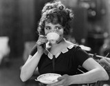 Portrait of woman drinking from teacup  - 104447029