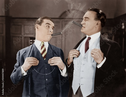 Photo Two men smoking cigars