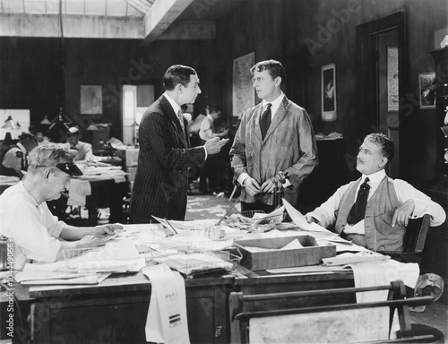 Poster Retro Four men at an office