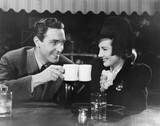 Couple toasting with mugs  - 104450625