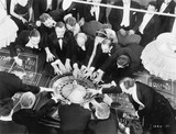High angle of a group of people playing roulette  - 104452437