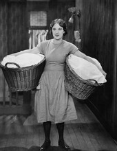 Woman Carrying Laundry Baskets