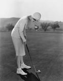 Kobieta w golfa - 104454011