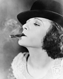 Closeup of woman smoking cigar  - 104457097