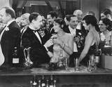 Couple having drink at crowded bar  - 104458877