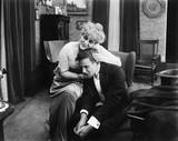 Woman consoling a sad man  - 104459839