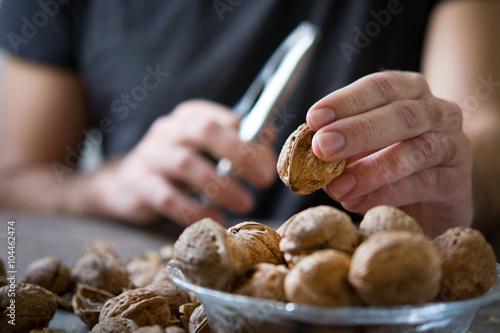 Man cracking nuts