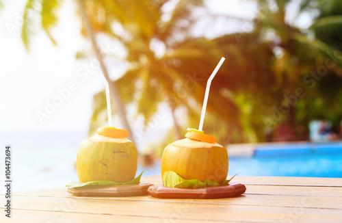 Fotografie, Obraz  two coconut drinks served in luxury resort